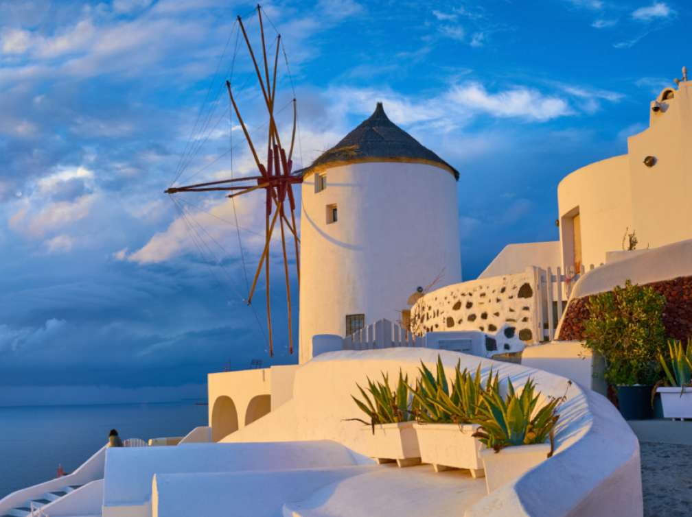 Windmill in the village of Oia at sunset, Santorini, Greece